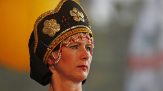 Woman wearing a traditional headdress at the Folkloria, a folk dancing festival in Karlsruhe